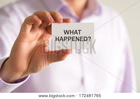 Businessman Holding A Card With Text What Happened ?