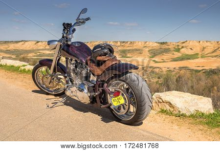 ESHKOL NATIONAL PARK. ISRAEL - FEBRUARY 17, 2017: Custom Chopper motorcycle on desert and blue sky background