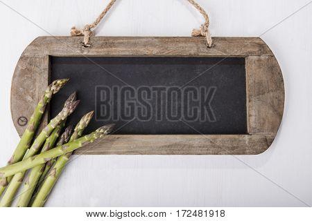 Fresh green asparagus and blackboard
