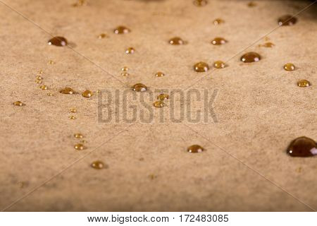 Drops of oil on baking paper