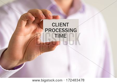 Businessman Holding A Card With Text Client Processing Time