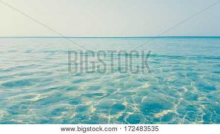 shallow water wave and clearly blue sky background