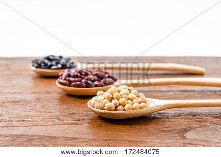 Soy Beans, Kidney Beans, Black Beans On Dark Wooden Background