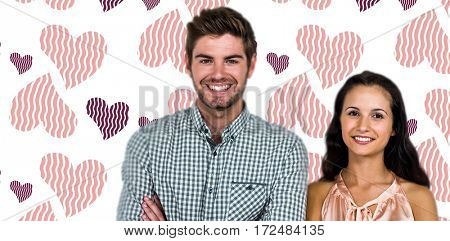 Smiling couple with arms crossed against background with hearts