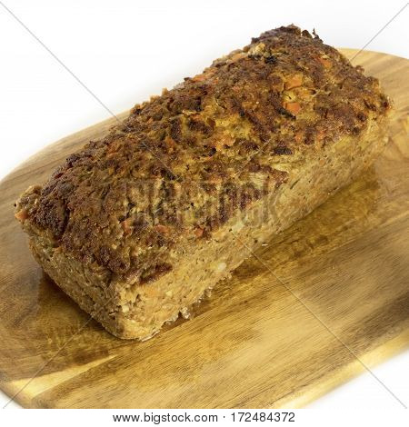 A square photo of freshly cooked meatloaf on a wooden board, on white background