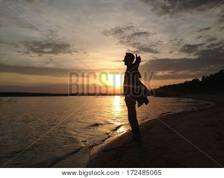 Sillhouette of man at sunset near Volga river near Kazan, Russia: 15 July 2016