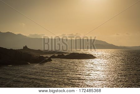 Sun Setting Over A Genoese Tower And Calvi In Corsica