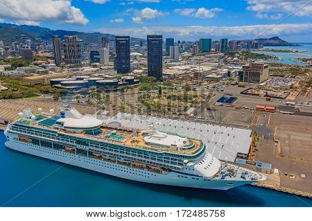 Oahu Hawaii - May 25 2015: Aerial view of downtown Honolulu Hawaii and a cruise ship from a helicopter