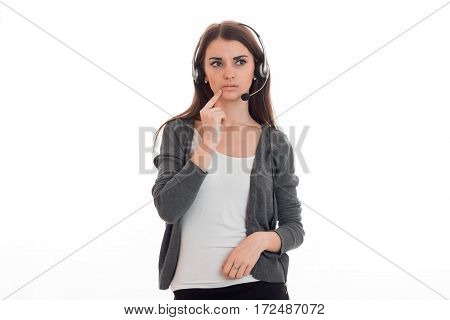 brooding young girl looks toward standing with headphones isolated on white background