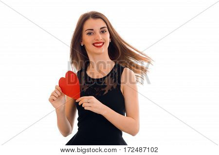cheerful beautiful girl girl in black dress holding a Valentine isolated on white background