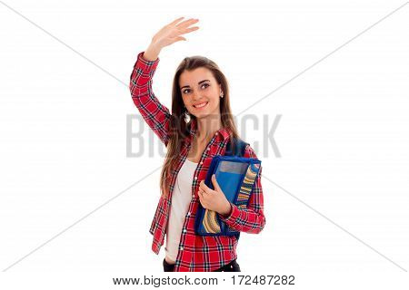 a cheerful young girl in Plaid Shirt raised hand up isolated on white background