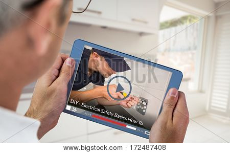 Fast forward sign on digitally generated blank screen against man using digital tablet and smart phone at table