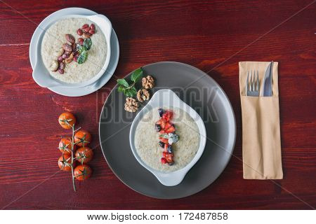 Plates with porridges with fruits, nuts, healthy Breakfast food, top view