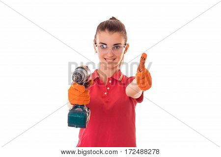 smiling young girl is stretched out in a hand drill and shows the class of isolated on white