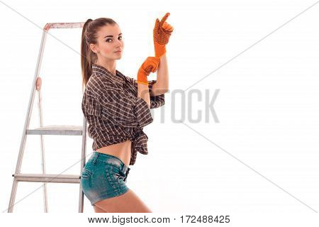 young girl in shorts and shirt worth gloves near the stairs is isolated on a white