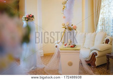 Beautiful wedding decoration. Angels and flowers. Wedding ceremony