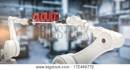 Robotic hands holding red cloud text against white background against factory