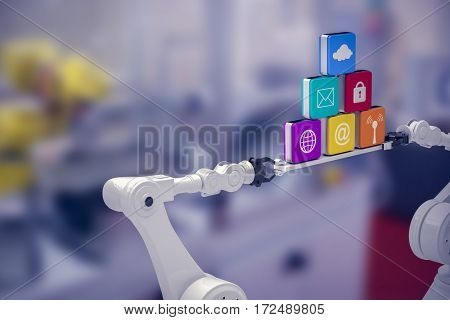 White robotic hands holding computer icons against white background against image of machinery