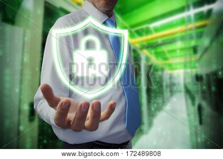 Businessman holding hand out against image of data storage
