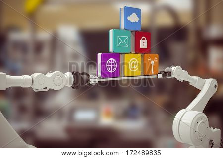 Digitally composite image of white robotic hands holding computer icons against machine in industry