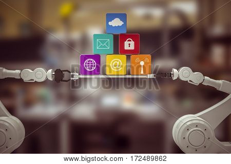 Robotic hands holding multi colored computer icons over white background against image of machinery