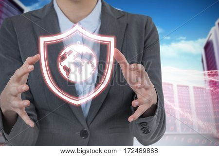 Woman gesturing against white background against composite image of server towers