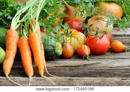 Healthy food ingredients background. Vegetables and herbs on wooden background.