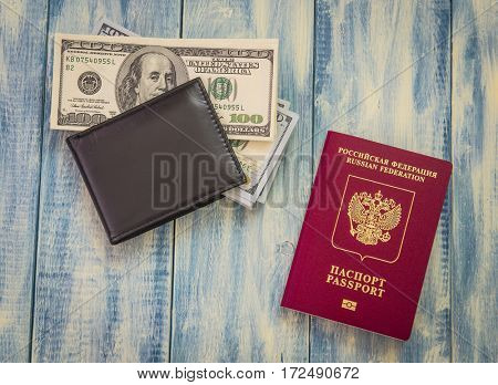 Russian passport, wallet and dollar bills