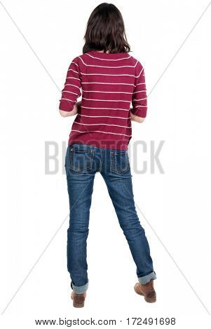 back view of standing young beautiful  brunette woman in red pullover. girl  watching. Rear view people collection.  backside view of person.  Isolated over white background.