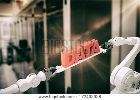 Metallic robotic hands holding red data text over white background against servers cabin