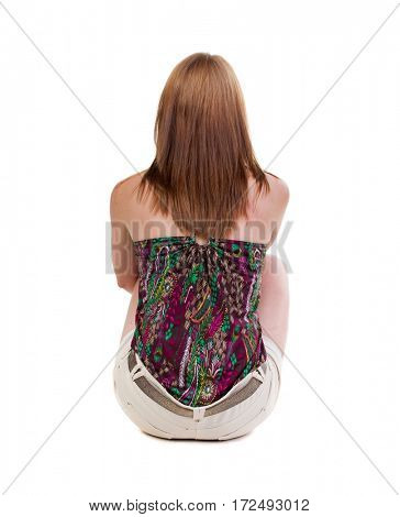 back view of standing young beautiful  blonde woman in shorts sitting. girl  watching. Rear view people collection.  backside view of person.  Isolated over white background.