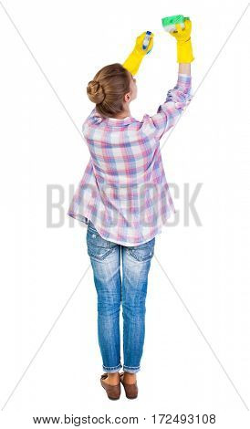 Back view of a housewife in gloves with sponge and detergent. girl  watching. Rear view people collection.  backside view of person.  Isolated over white background.