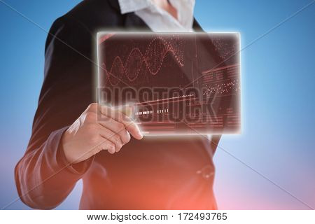 Midsection of businesswoman holding glass digital tablet against helix diagram of dna