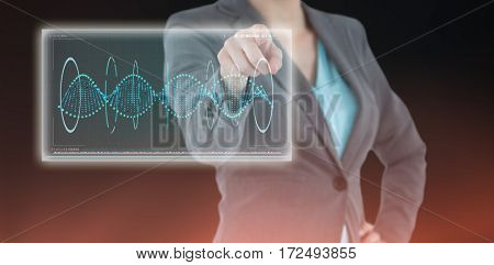 Businesswoman using digital screen against blue background with vignette