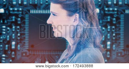 Smiling businesswoman looking away against futuristic blue circuit board