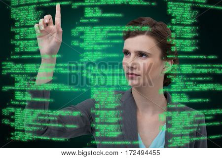 Businesswoman with arms raised while using digital screen against green background with vignette