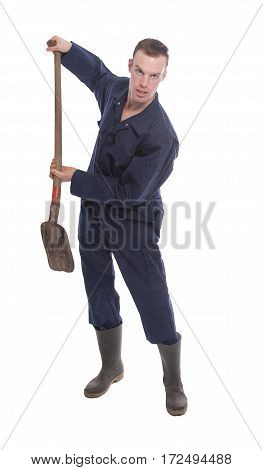 Young farmer with shovel isolated on white background