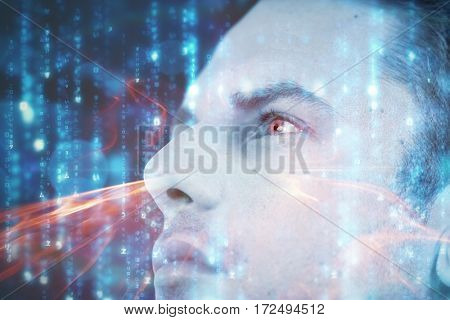 Close-up of man wearing contact lens against glowing matrix