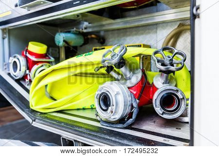 Fire hoses and connections in truck of fire brigade