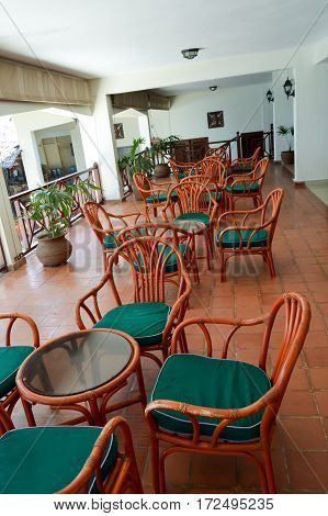 Terrace with wooden furniture and table ro Mombasa Kenya