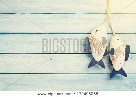 Sunny travel vacation wooden background with fish decor. Top view with copy space
