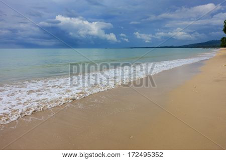 Landscape with sandy beach on the background of a stormy sky, Thailand