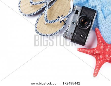 Beach accessories. Flip flops, camera and towel. Isolated on white background. Top view with copy space