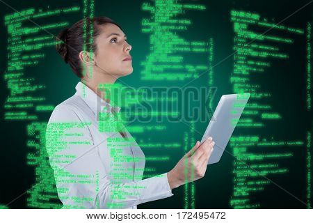 Businesswoman holding digital tablet against green background with vignette