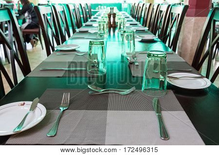 Elegant served indoor table with wine glasses