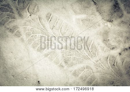 Diagonal traces of car tires on the snow. Close up view from above