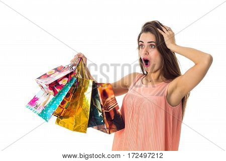 girl raised with surprise packets to itself and keeps hand hair isolated on white