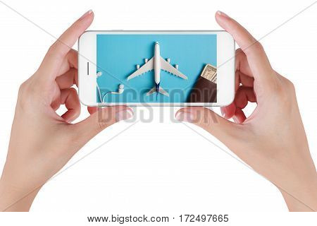Woman hand using smart phone searching Preparation for Traveling with airplane money passport earphone and book. Travel concepts Isolated on white background.