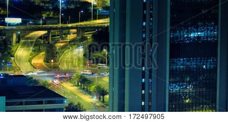 Cars moving on road seen through window at night blur