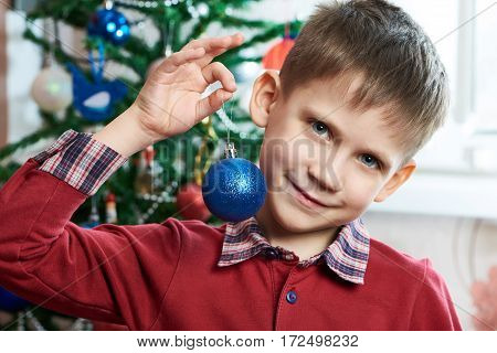 Happy Child With Christmas Toy Ball